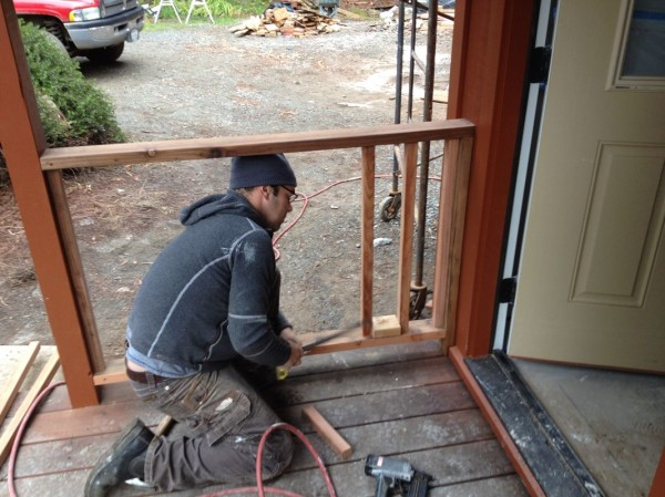Matt working on deck railing