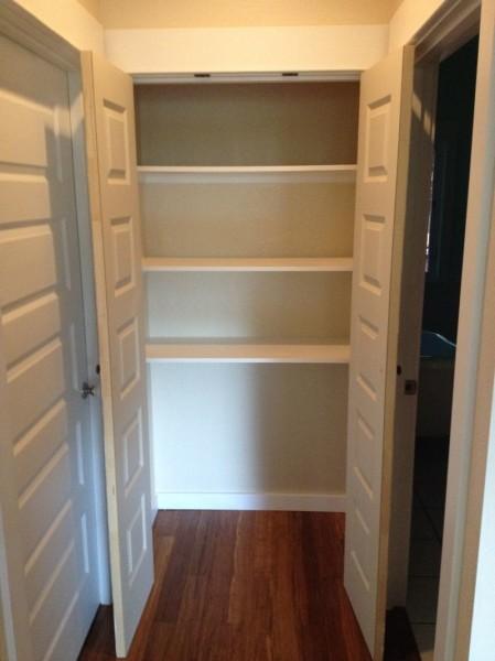 Simple shelves for hallway linen closet